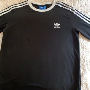 Adidas Originals black three striped tee.